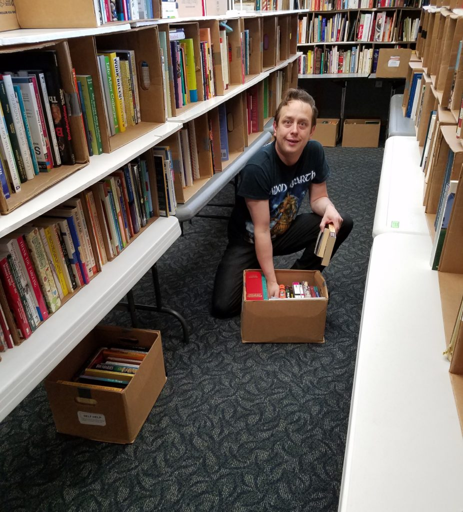 When we run out of room on the tables, we start stashing books on the floor underneath. (Pat Harper photo)